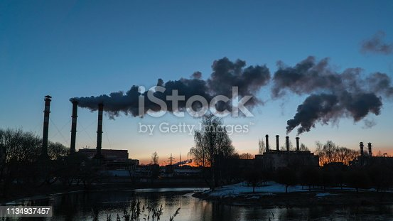 istock Air pollution from industrial plant pipes 1134937457