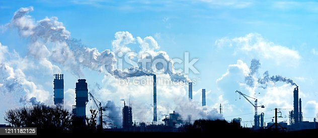Air pollution from smoke coming out of factory chimneys.