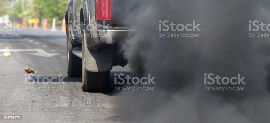 Air pollution from vehicle exhaust pipe on road – Foto