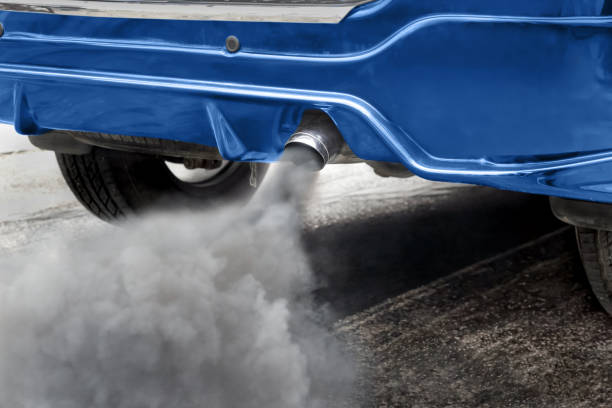 air pollution from vehicle exhaust pipe on road - pollution stock pictures, royalty-free photos & images