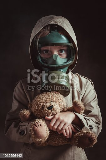 Little girl wearing gas mask. Air pollution concept.