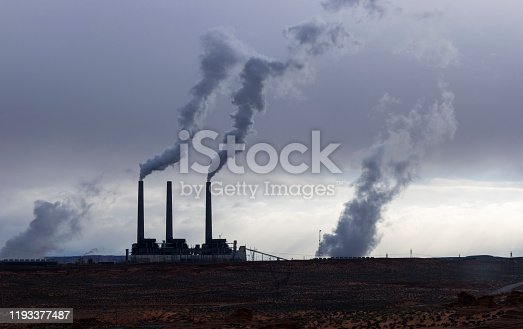 Lots of smoking chimneys in a dark environment