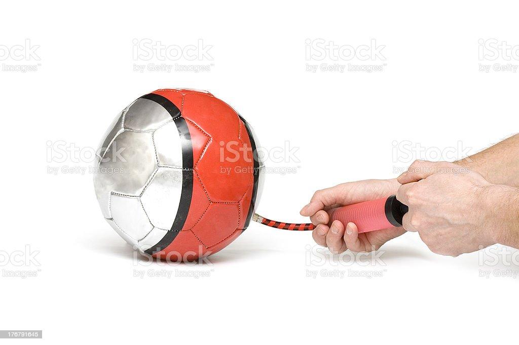 Air pump inflates ball royalty-free stock photo