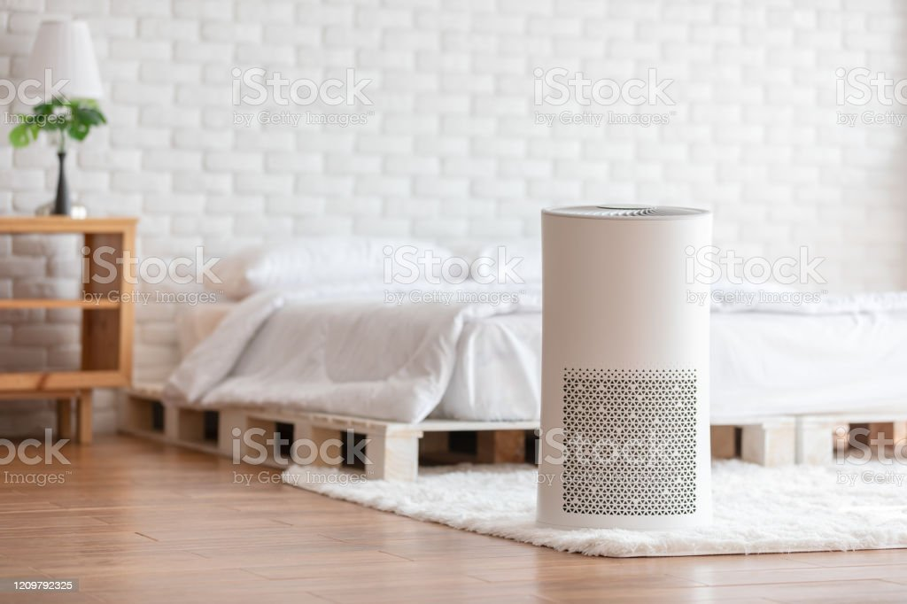 Air Purifier In Cozy White Bed Room For Filter And Cleaning Removing Dust Pm25 Hepa In Homefor Fresh Air And Healthy Lifeair Pollution Concept Stock Photo Download Image Now Istock