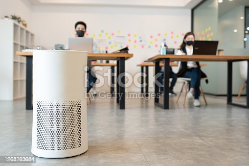 Air purifier in modern office for fresh air and removal dust PM 2.5