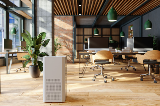 Air Purifier In Modern Open Plan Office For Fresh Air, Healthy Life, Cleaning And Removing Dust.