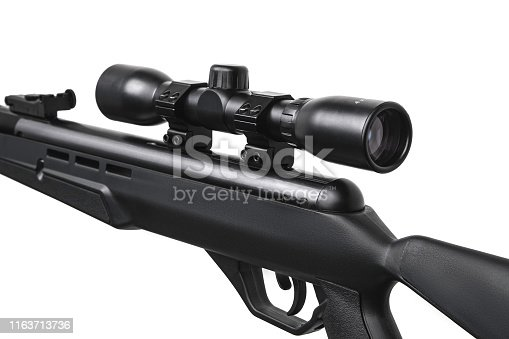 Air rifle with a telescopic sight isolate on a white background. Pneumatic gun. Sports air rifle for accurate aiming shooting.