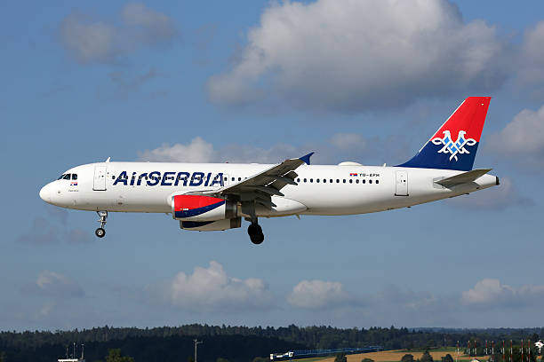 air serbia airbus a320 airplane zurich airport - serbia stock photos and pictures