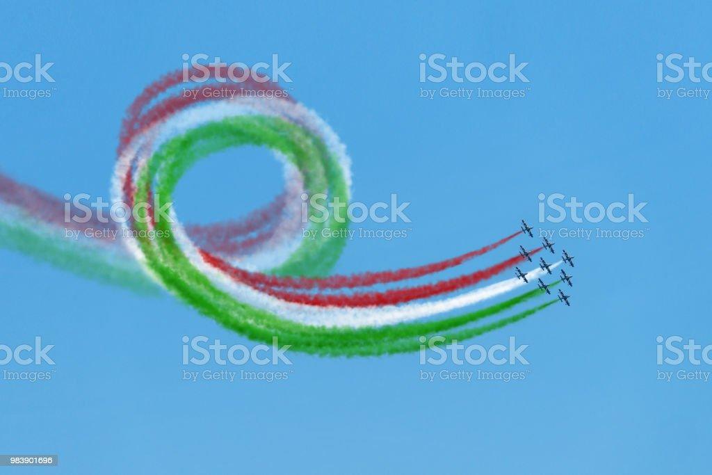 Air show aerobatic italian team frecce tricolore flying loop stock photo