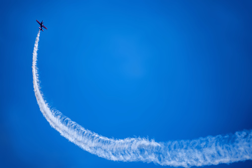 sports plane against a blue sky