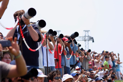 Izmir, Turkey - June 4, 2011 : A group photographer concentrates on getting pictures of the aircrafts taking part in the 2011 Air Show Turkey, held in celebration of the 100th anniversary of the Turkish Air Force at the Cigli Air Base, Izmir.