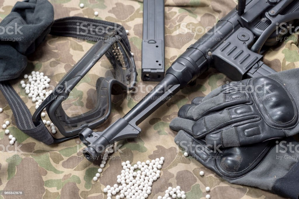 air soft gun with protective glasses and a lot of bullets zbiór zdjęć royalty-free