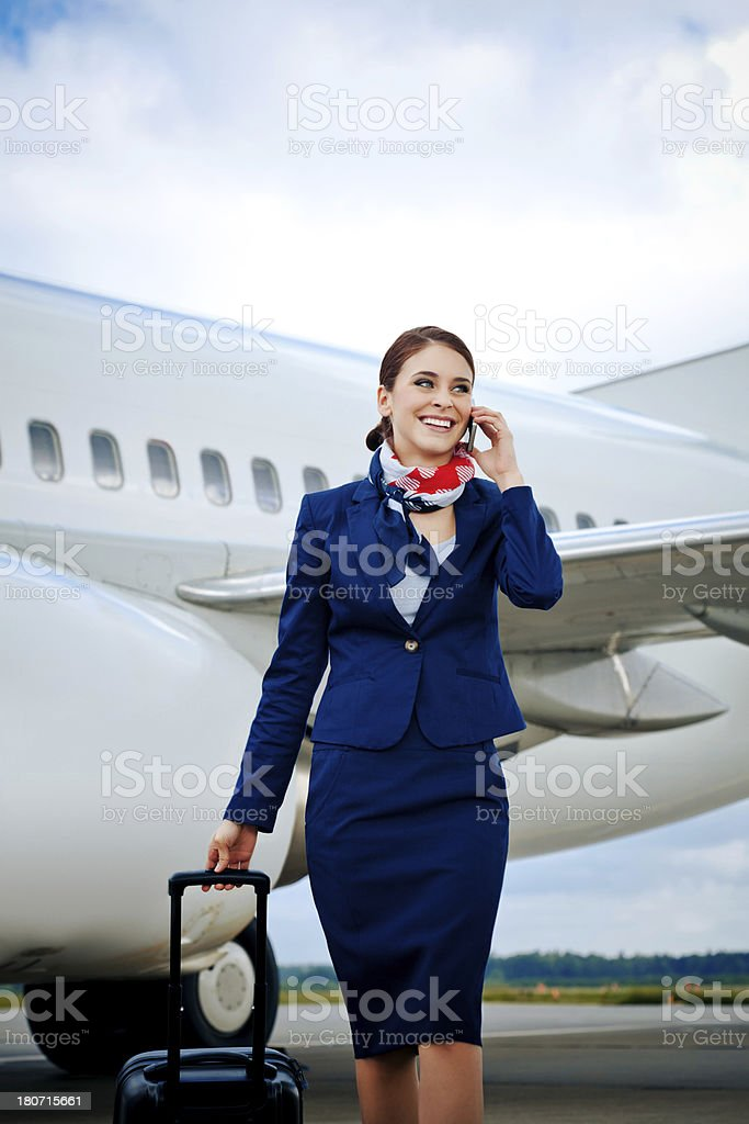 Air stewardess talking on phone stock photo
