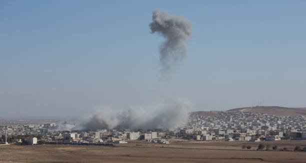 Air strikes Bomb in Kobane in Syria military attack stock pictures, royalty-free photos & images