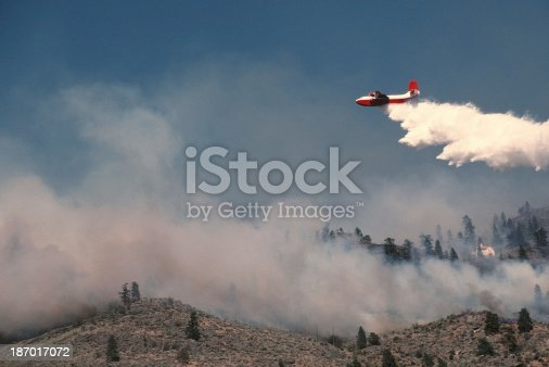 A water bomber drops water on a fire on Anarchist Mountain near Osoyoos, BC, Canada.