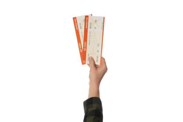 air ticket in hand isolated on white background. planning trip, summer vacation - biglietto foto e immagini stock