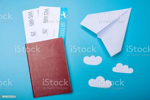 Air tickets with passport and paper plane on blue background topview picture id959533534?b=1&k=6&m=959533534&s=612x612&h=ekwd6q9men1bijsoih14eo8tsejpneokjqkwpvj82ny=