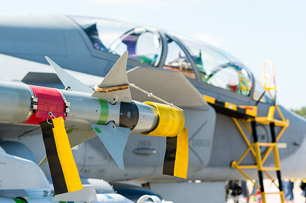 Air to air missile Kallinge, Sweden - June 01, 2014: Swedish Air Force air show 2014 at F 17 Wing. Air to air missile with protection cap and flag. SAAB JAS 39 Gripen. saab stock pictures, royalty-free photos & images