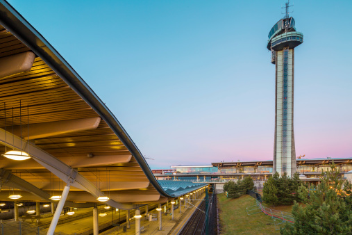 Air Traffic Control Tower And Railway Station At Dusk Stock Photo - Download Image Now