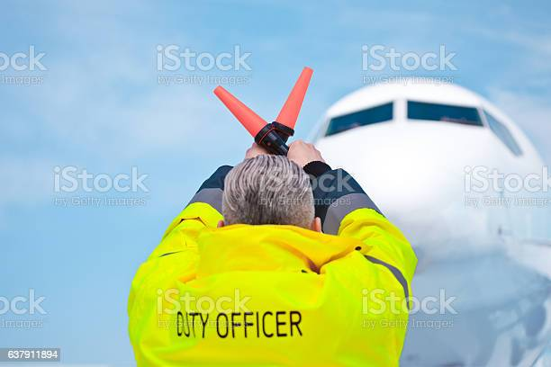Air Traffic Controler Holding Signals Stock Photo - Download Image Now