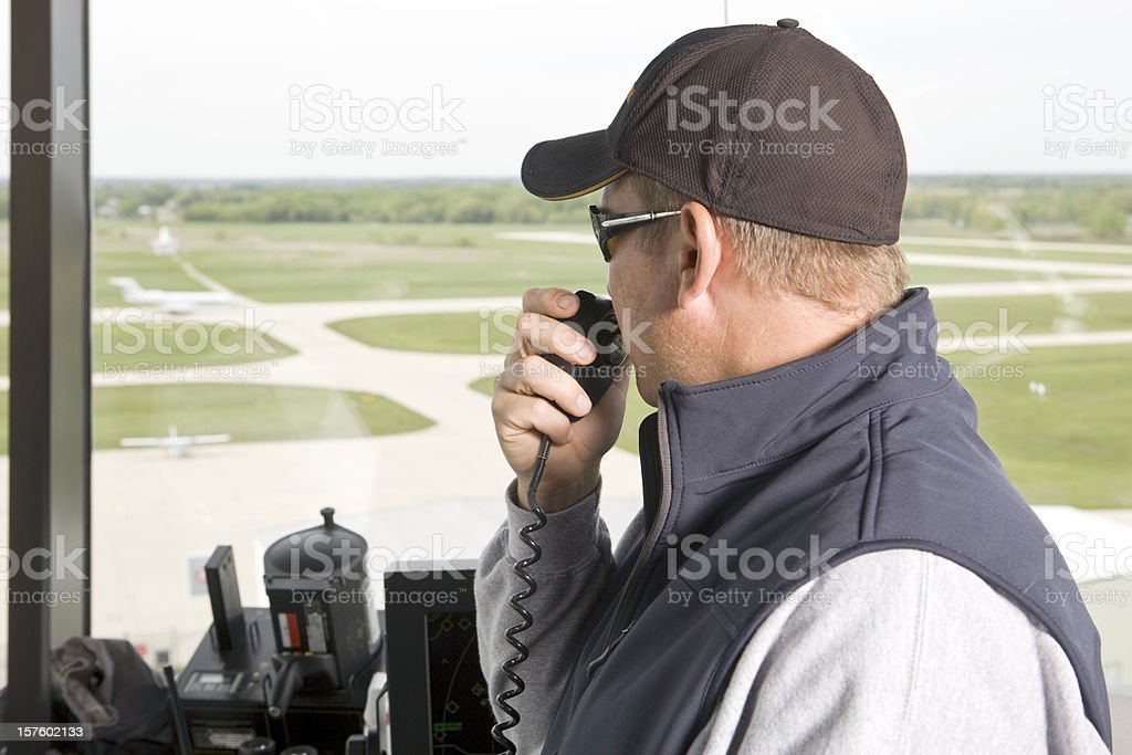 Air Traffic Controller Directing Landed Plane from Control Tower stock photo