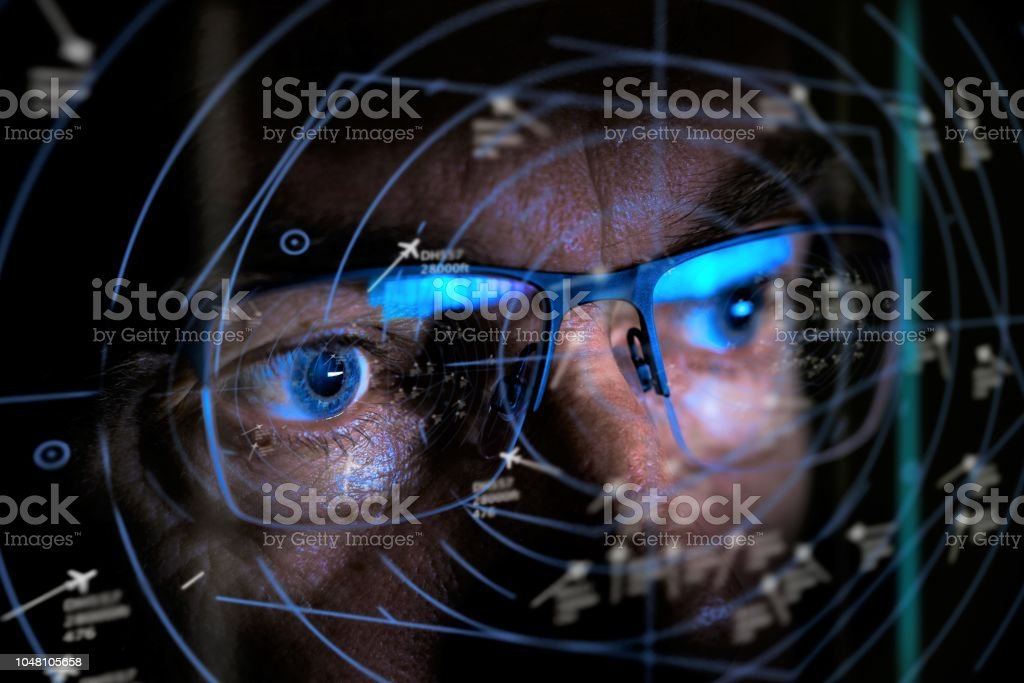 air traffic controller looking at screen stock photo