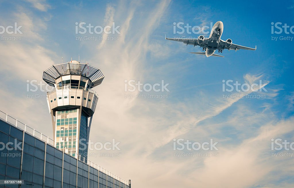 Air Trafic Control tower and airplance at Paris Airport stock photo