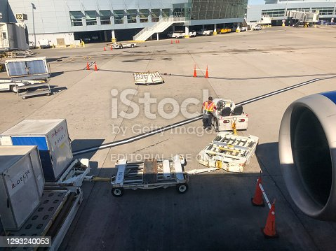 Las Vegas, USA - Sep 30, 2019: A Delta cargo container being loaded on a departing jet at the Las Vegas Airport late in the day.