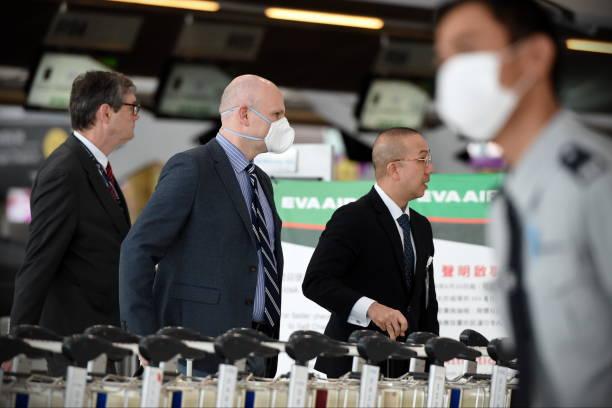 Air Travelers Wear Masks as a Precaution against Covid-19 stock photo