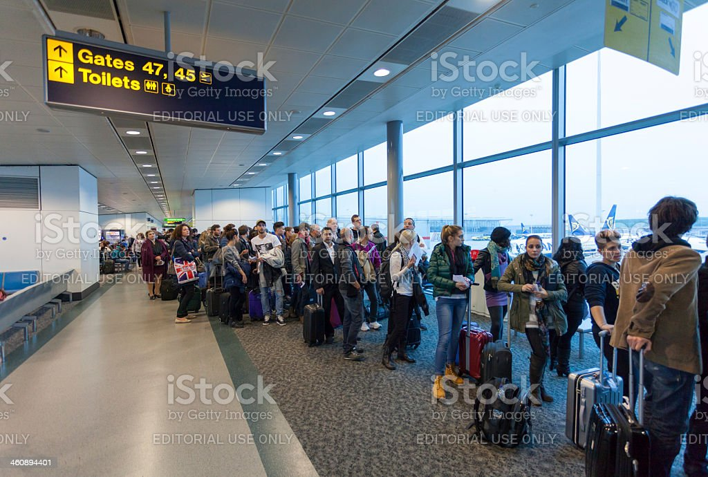 Air traveller waiting in queue for boarding stock photo