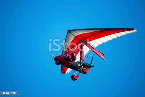 A picture of an air trike in flight against the background of the blue sky.