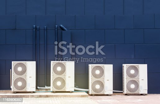 939450782 istock photo Air ventilation system installed outside of the building 1163906352