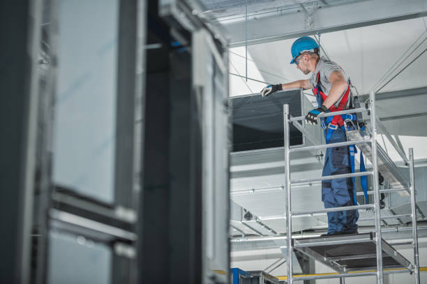Air Ventilation Technician Checking Installed Shaft. stock photo