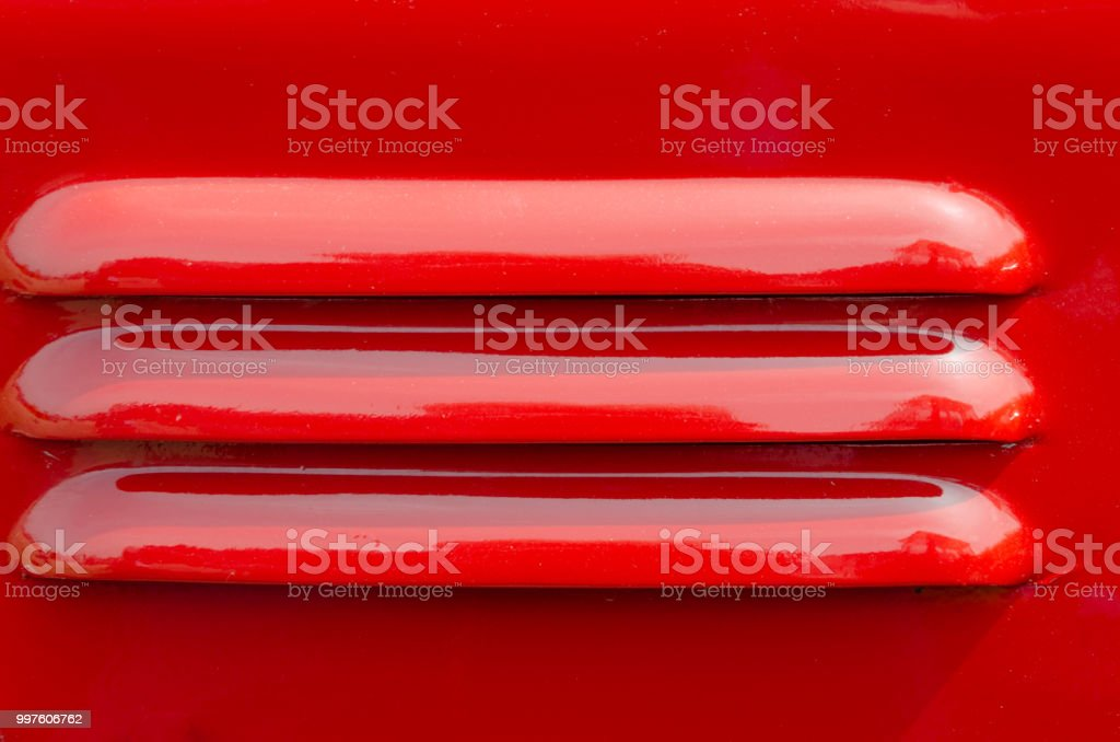 Air vents on a red panel stock photo