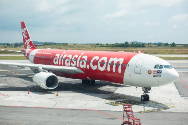 AirAsia Berhad is a Malaysian low-cost airline. It is the largest airline in Malaysia by fleet size and destinations. Oct 2019 - Kuala Lumpur, Malaysia: AirAsia Berhad is a Malaysian low-cost airline. It is the largest airline in Malaysia by fleet size and destinations. kuala lumpur airport stock pictures, royalty-free photos & images