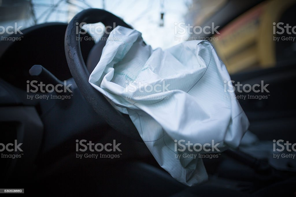 Airbag exploded at a car accident stock photo
