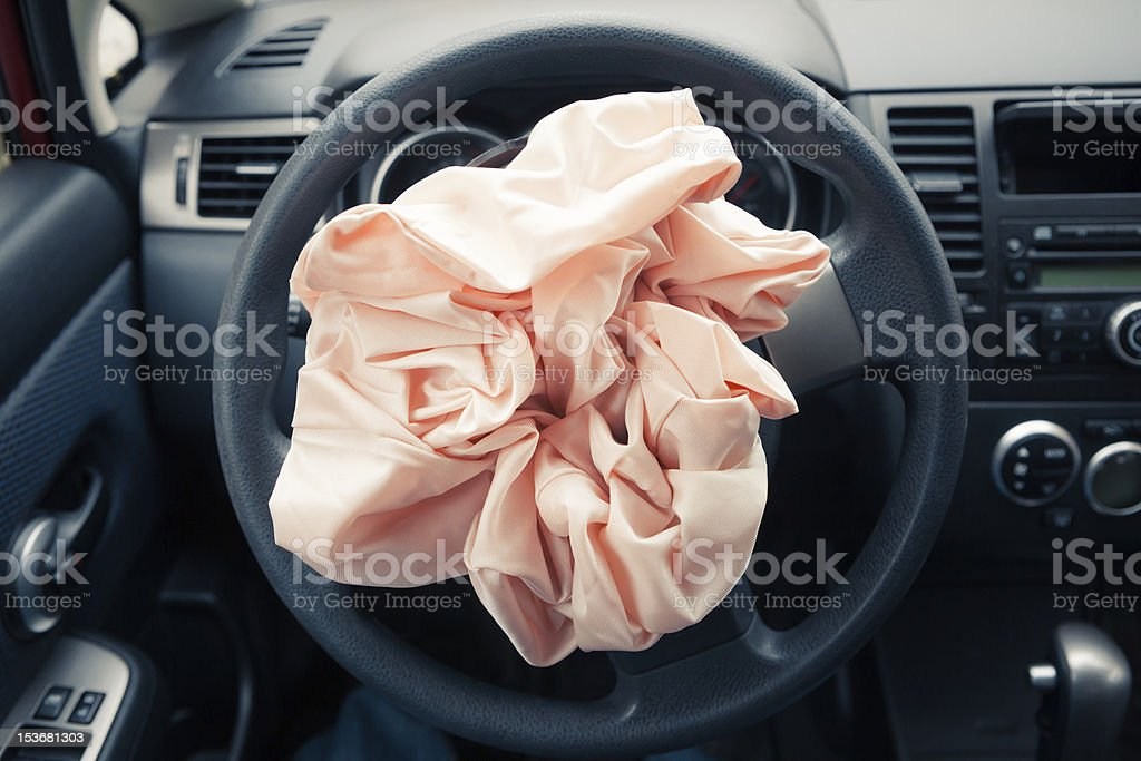 Airbag explodes on steering wheel stock photo