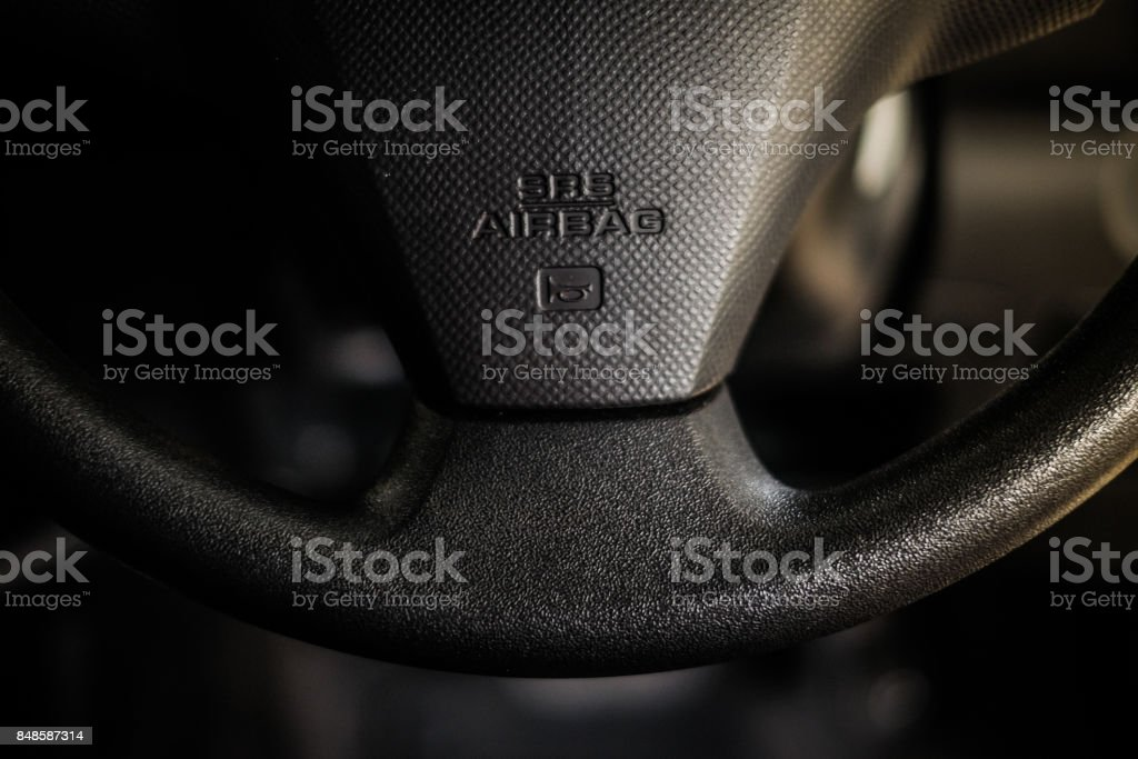 SRS (supplemental restraint system) airbag (vehicle safety device) for reduce the risk of injury in crashes and car horn sound sign in steering wheel - interior car concept. stock photo