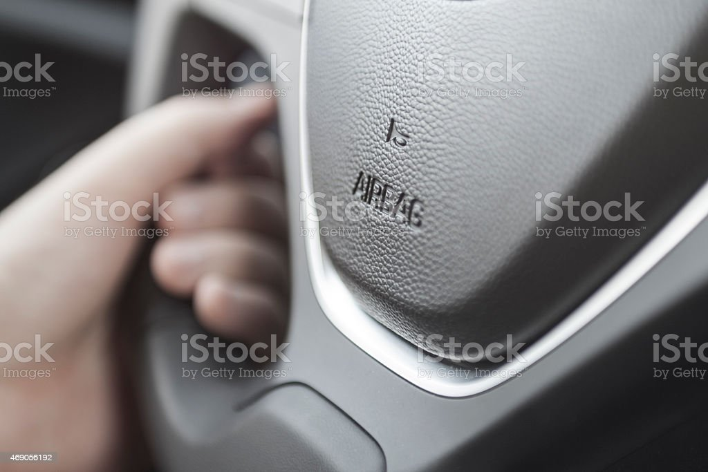 airbag icon on steering wheel stock photo