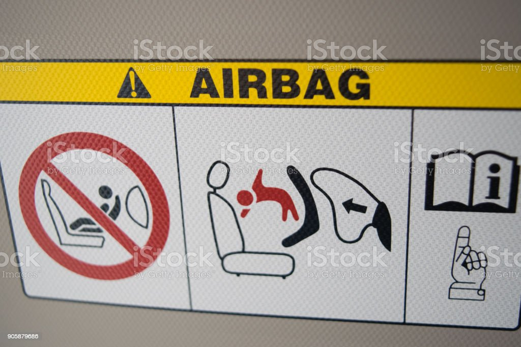 airbag plate warning in city car, on sunshade stock photo