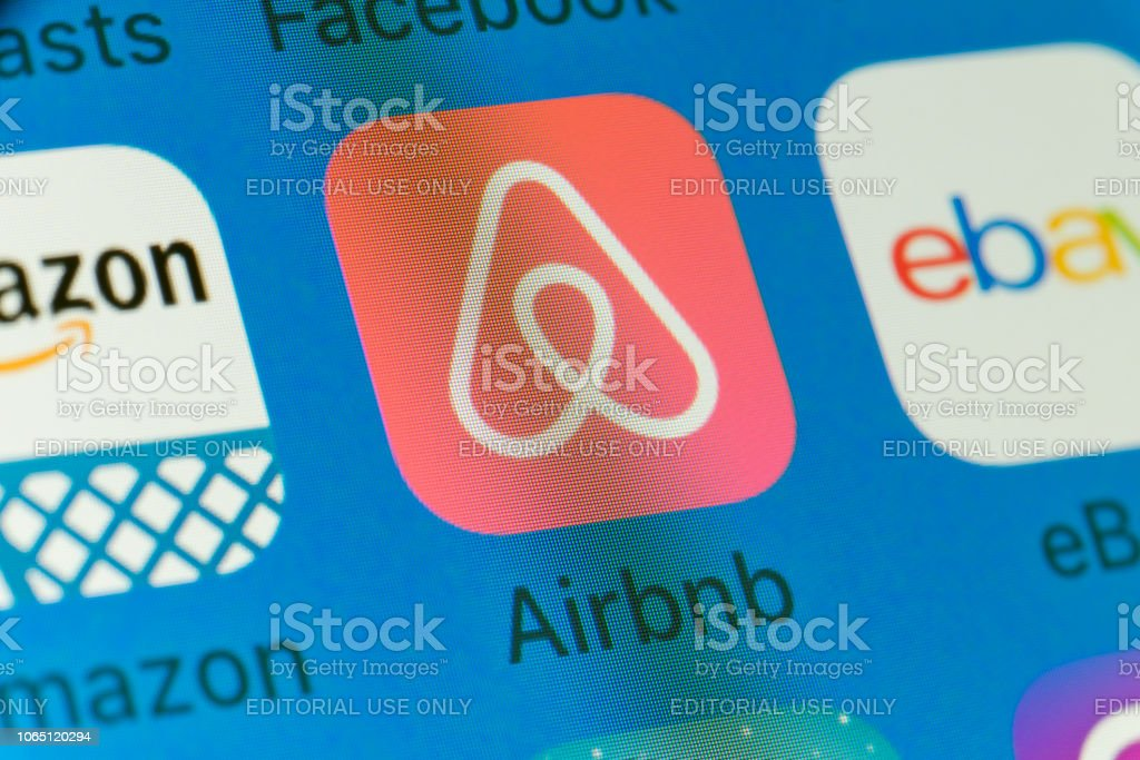 Airbnb, Amazon, eBay and other cellphone Apps on iPhone screen stock photo