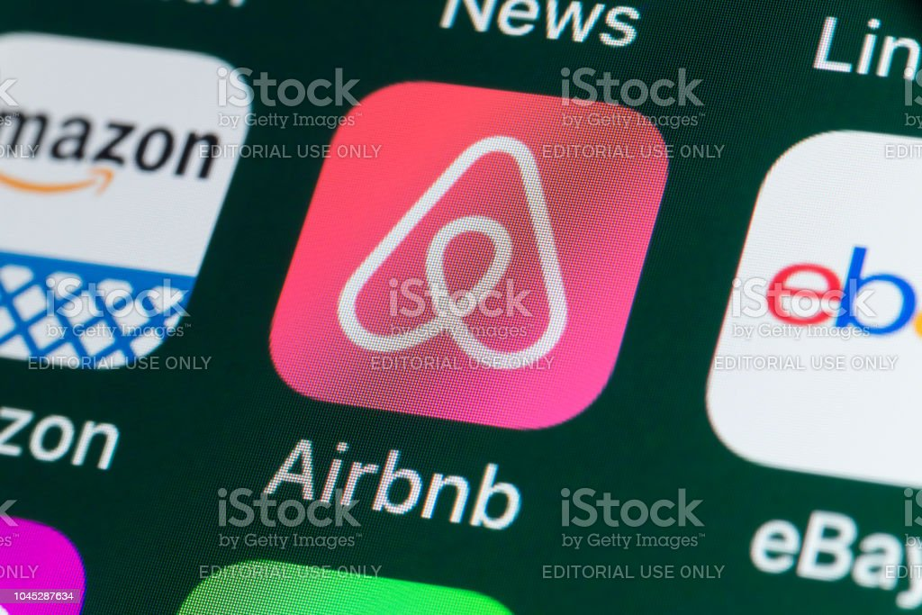 Airbnb, Amazon, ebay, News and other Apps on iPhone screen stock photo
