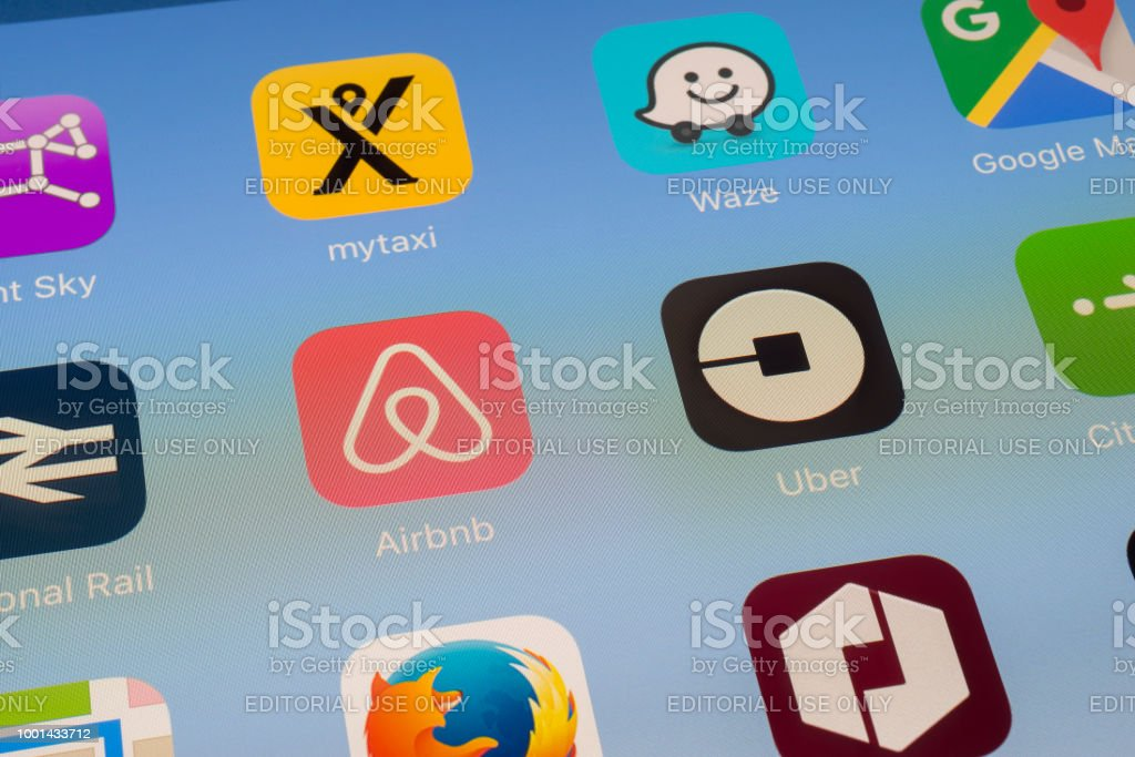 Airbnb Uber And Other Travel Apps On Ipad Screen Stock Photo