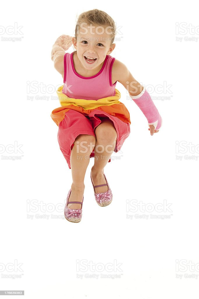 Airborn! Smiling Girl with Cast on Broken Arm stock photo