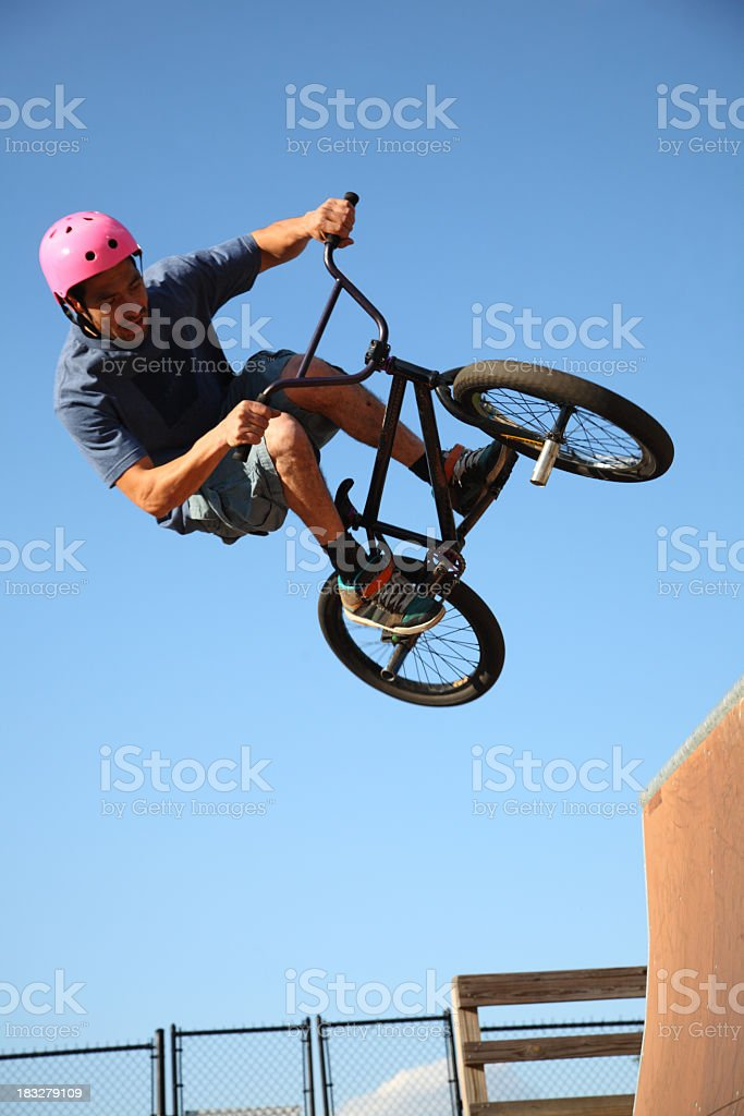 Airborne BMX Rider Above Outdoor Ramp royalty-free stock photo