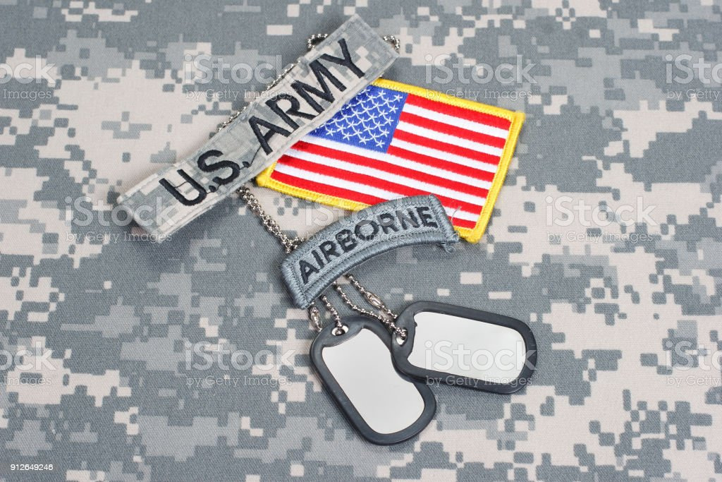 US ARMY airborne tab with blank dog tags on camouflage uniform stock photo