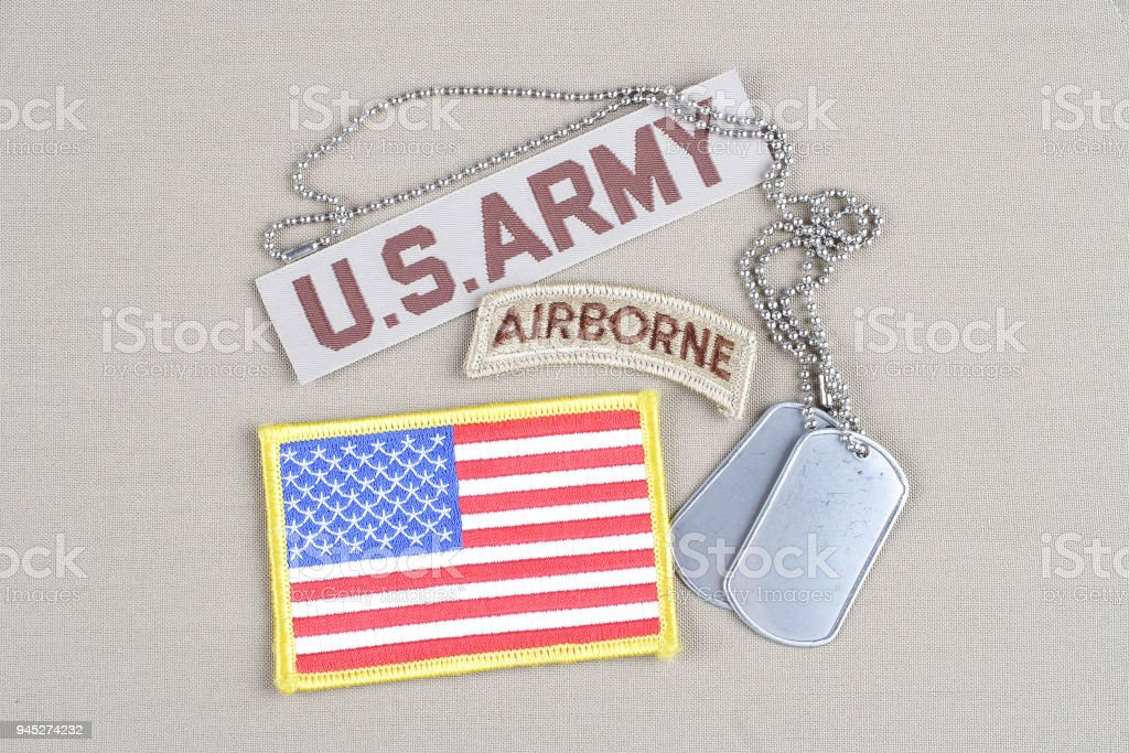 US ARMY airborne tab with dog tag and flag patch stock photo