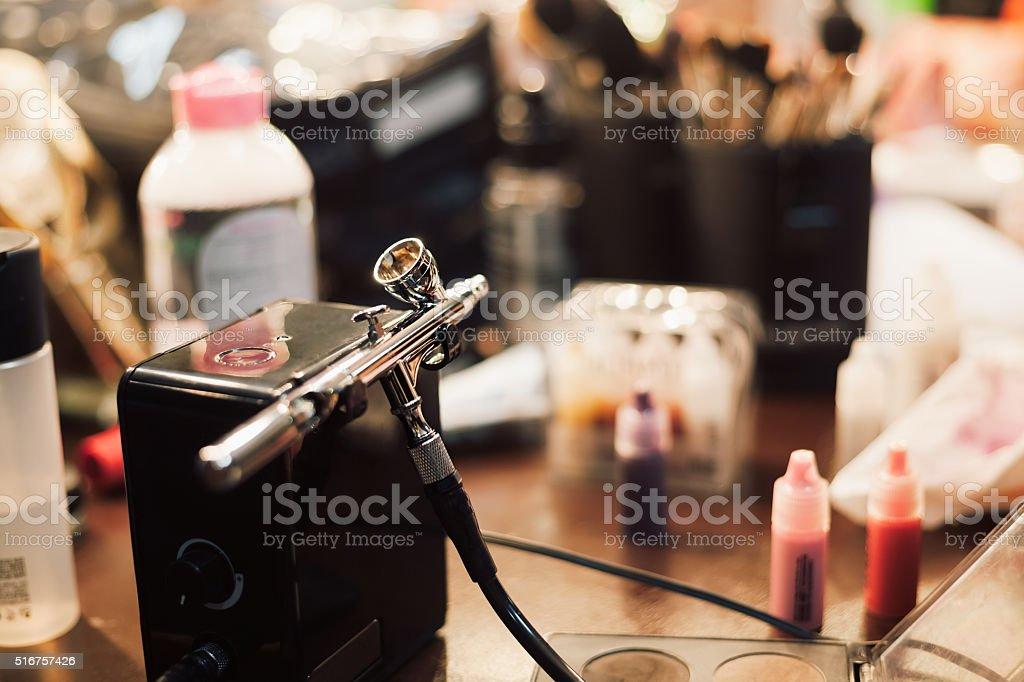 Airbrush and paint for professional make up and body art stock photo