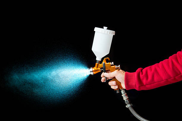 airbrush paint sprayer on black airbrush paint sprayer isolated on black airbrush stock pictures, royalty-free photos & images
