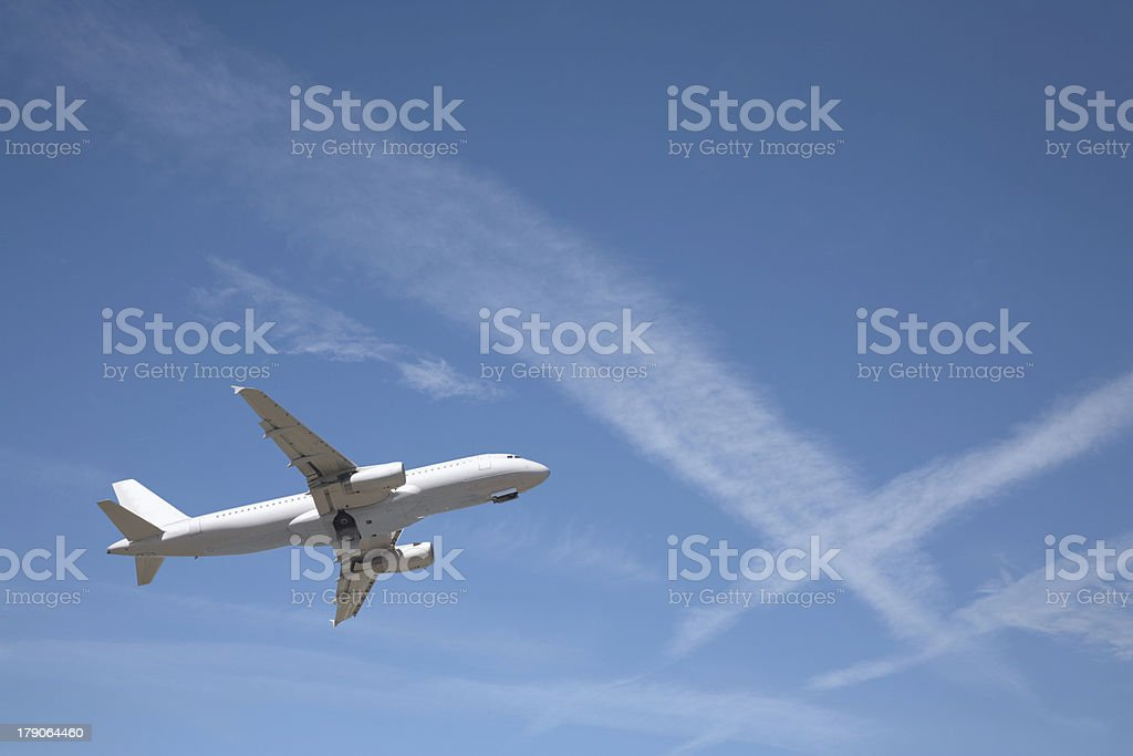 Airbus 320 and Con Trails stock photo